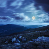 Mountain hillside with white boulders at night Royalty Free Stock Photography