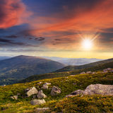 Mountain hillside with white boulders at sunset Royalty Free Stock Images
