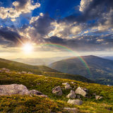 Mountain hillside with white boulders at sunset Royalty Free Stock Photo