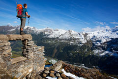 Mountain holiday. Young man with backpack enjoying mountain view Stock Photography