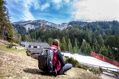 Mountain holidays. Hiking. Woman and nature. Backpack behind. Royalty Free Stock Images