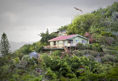 Mountain home. Beautiful small home on the side of a lush green mountain Royalty Free Stock Photo