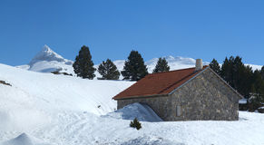 Mountain home with trees and snow, Navarre Pyrenees Stock Image