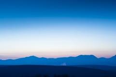 Mountain horizon in sunrise Stock Photos