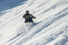 Mountain horse husaberg  on a motorcycle in winter forest in the mountains. SAKHALIN RUSSIAN - JANUARY 23 :Arkadiy Rybak moving mountain horse husaberg  on a Stock Photos