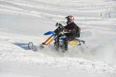 Mountain horse husaberg  on a motorcycle in winter forest in the mountains. SAKHALIN RUSSIAN - JANUARY 23 :Kosty Glushko moving mountain horse husaberg  on a Stock Image