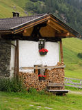 Mountain House. Typical mountains house with firewood for the winter Royalty Free Stock Photos