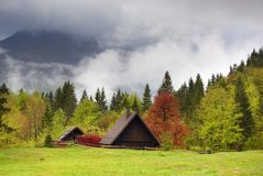 Mountain house in fog clouds at spring Stock Photo