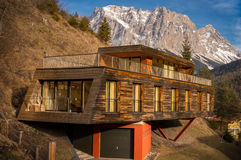 Mountain house with modern architecture Royalty Free Stock Photos