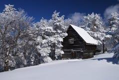 Mountain house in snow Royalty Free Stock Photos