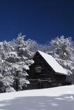 Mountain house in snow Stock Photo