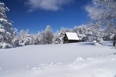 Mountain house in snow Royalty Free Stock Photo