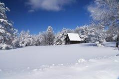 Mountain house in snow Royalty Free Stock Photo