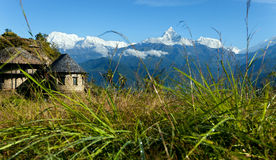 Mountain house and snow peaks Stock Photography