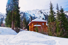 Mountain house in winter Stock Images