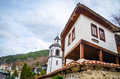 Mountain houses and church Stock Photo