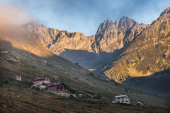 Mountain houses with clouds in Ayder Plateau, Rize, Turkey Royalty Free Stock Image