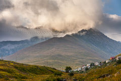 Mountain houses with clouds in Ayder Plateau, Rize, Turkey Stock Photo