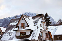 Mountain houses covered with fresh snow in Chocholowska valley Royalty Free Stock Photos