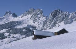 Mountain hut. In deeply snowcovered landscape near Jaun-Pass royalty free stock photography
