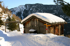 A mountain hut. Covered by snow in Wallis, Switzerland Stock Images