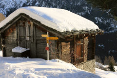 A mountain hut. Covered by snow in Wallis, Switzerland Stock Photos