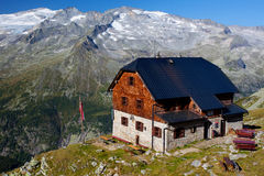 Mountain hut. In Austrian Alps with glacier peak in the background Royalty Free Stock Image