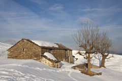 Mountain hut. In a landscape with snow Royalty Free Stock Photos