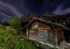 Mountain Hut. Night view of a wooden hut in the Swiss mountain village of Gimmelwald, with Mount Eiger in the background Royalty Free Stock Photos
