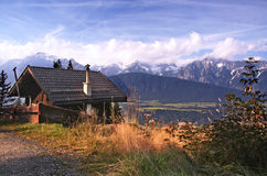 Mountain Hut. Pretty panorama with wooden hut and Karwendel mountain range in Austria / Tirol region Royalty Free Stock Images