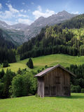 Mountain hut in the alps. A typical wooden hut somewhere in the alps royalty free stock image