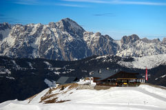 Mountain hut in alps with snow ridge winter Stock Image
