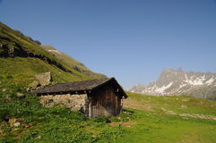 Mountain hut in the Alps in springtime Royalty Free Stock Photography