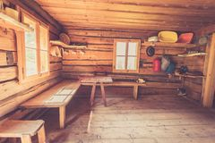 Mountain hut in Austria: rustic wooden interior. Interior of an old rustic abandoned alpine chalet in Austria mountain indoors wooden adventure hut rest hiking stock photography