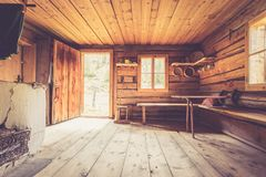 Mountain hut in Austria: rustic wooden interior. Interior of an old rustic abandoned alpine chalet in Austria mountain indoors wooden adventure hut rest hiking stock photos