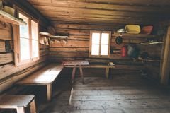 Mountain hut in Austria: rustic wooden interior. Interior of an old rustic abandoned alpine chalet in Austria mountain indoors wooden adventure hut rest hiking royalty free stock image