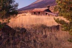 Mountain hut. Beautiful mountain hut in Sicily, Italy; Etna volcano on background Stock Photos