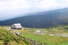 Mountain Hut and Camping Tents. Mountain landscape with a hut and camping tents high in the Rila mountains, Bulgaria Royalty Free Stock Photography