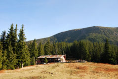 Mountain hut in Carpathians stock images