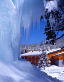 Mountain hut and icicles Stock Images