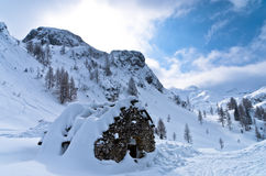 Mountain hut made of stones at winter in Slovenian Alps Royalty Free Stock Photo