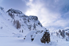 Mountain hut made of stones at winter in Slovenian Alps Royalty Free Stock Photos