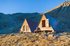 Mountain hut in the morning sunshine Royalty Free Stock Images