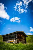 Mountain hut. A small mountain hut surrounded by grassland Royalty Free Stock Images