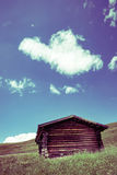 Mountain hut. A small mountain hut surrounded by grassland Royalty Free Stock Photos