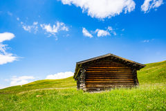 Mountain hut. A small mountain hut surrounded by grassland Stock Images