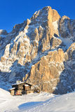 Mountain hut on the snow in the Alps Stock Images