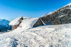 Mountain hut in the snow. Mountain hut under the snow in the cold winter in the beautifull day Royalty Free Stock Photography