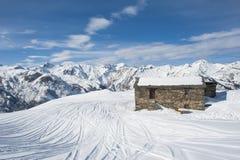 mountain hut in the snow Stock Photos