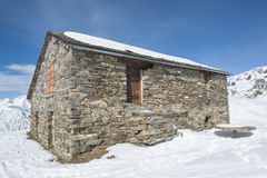 mountain hut in the snow Royalty Free Stock Images